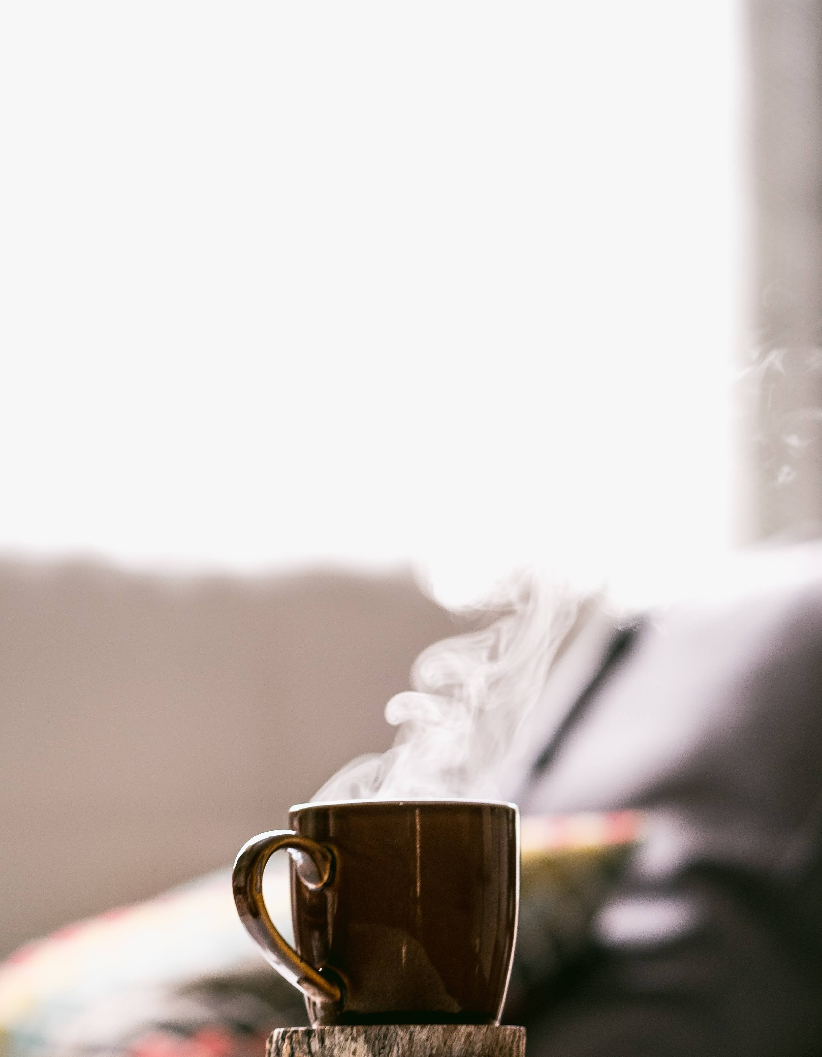 Shallow Focus Photography of Hot Coffee in Mug with Saucer | Photo by Tim Foster via Unsplash
