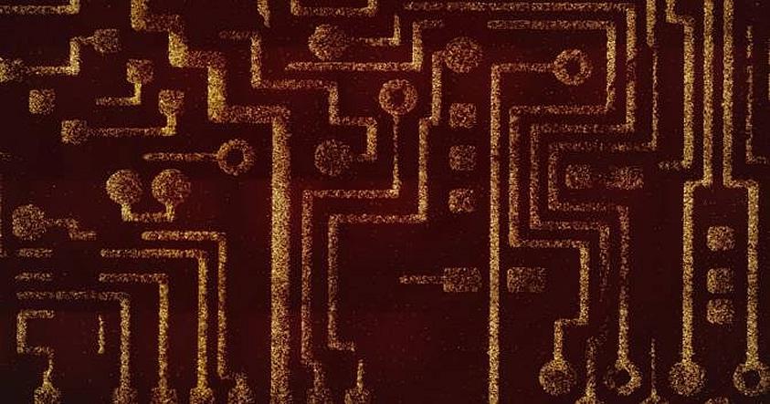 La imagen muestra una placa madre que ha sido microestampada usando bacterias probióticas programables. Las líneas brillantes están compuestas por puntos hechos de bacterias. La técnica fue desarrollada en el laboratorio de Sangeeta Bhatia en el MIT.