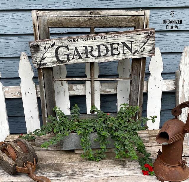 Photo of a window frame planter with verbena.