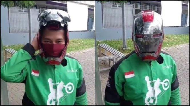 driver ojol menggunakan helm iron man
