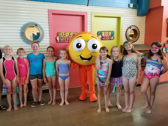 goldfish swim school mascot