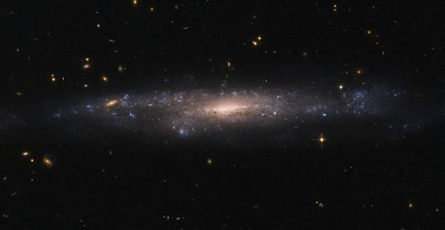 NASA/ESA Hubble Space Telescope image capturing UGC 477, a low surface brightness galaxy located just over 110 million light-years away in the constellation of Pisces (The Fish).