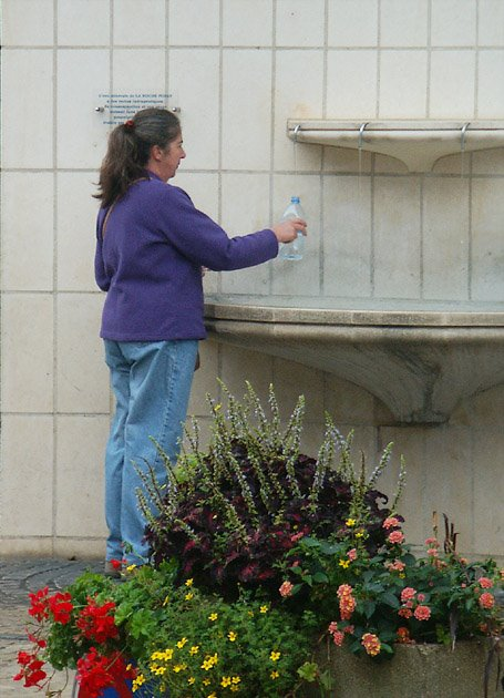 Collecting water from the public fountain at La Roche Posay, Vienne, France. Photo by Loire Valley Time Travel.