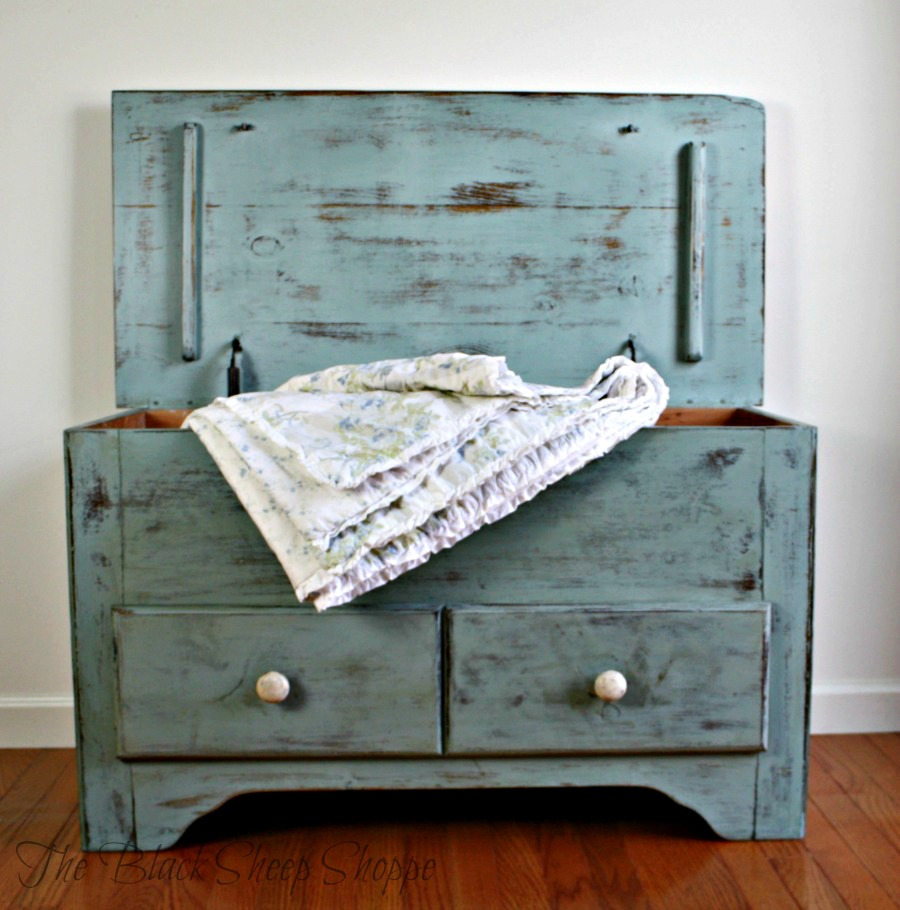 Blanket chest with top open.