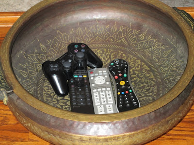 remotes in bowl