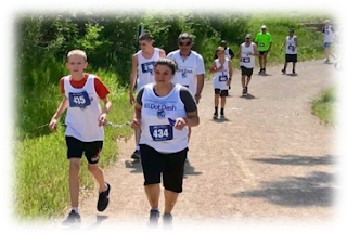 2018 NFBCO 6 Dot Dash 5k blind runners and sighted guides running along the Mary Carter Greenway in Littleton, Colorado