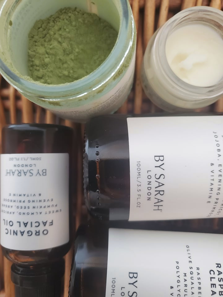 a selection of organic skincare products from By Sarah London laid out on a brown wicker basket