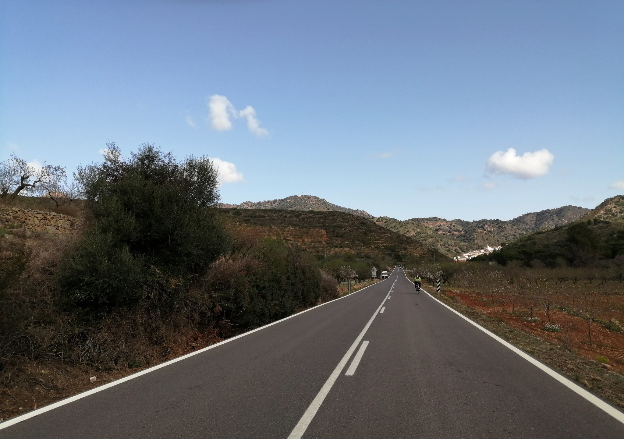 Cyclist approaching the village of Chóvar, Castellón, Spain