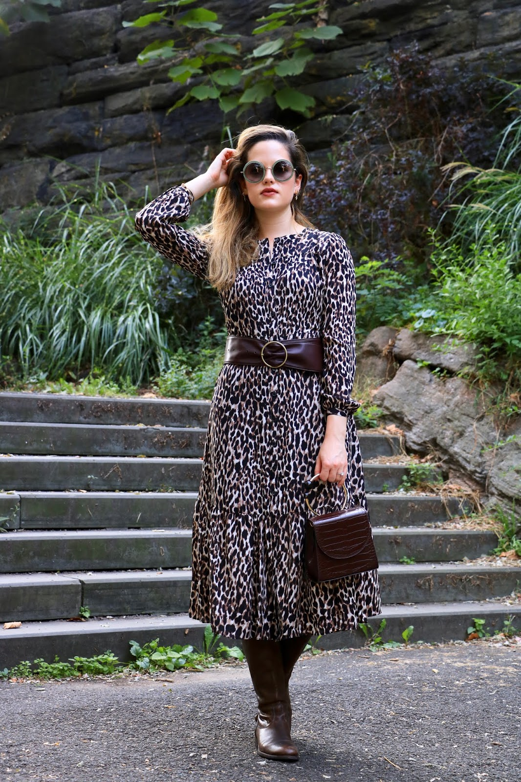 Nyc fashion blogger Kathleen Harper wearing a fall outfit of a midi dress and leather boots.