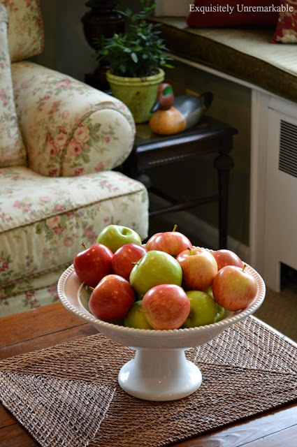 Apples in a bowl on a small coffee table