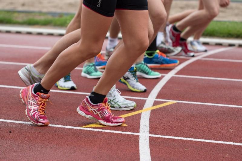Everyone is weaing sports shoe in a race.