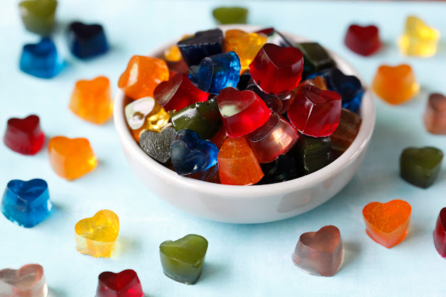 Small heart shaped gelatin dog treats in a rainbow of colours