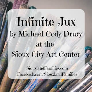 "in background, dirty wooden paintbrushes in a bundle against gray. in foreground, the words ""Infinite Jux by Michael Cody Drury at the Sioux City Art Center"" and ""SiouxlandFamilies.com"" and ""Facebook.com/SiouxlandFamilies"""