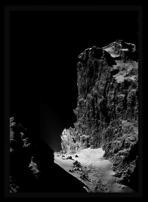 The cliffs on the surface of the comet Churyumov-Gerasimenko. That already cropped image is taken from Rosetta Navcam.