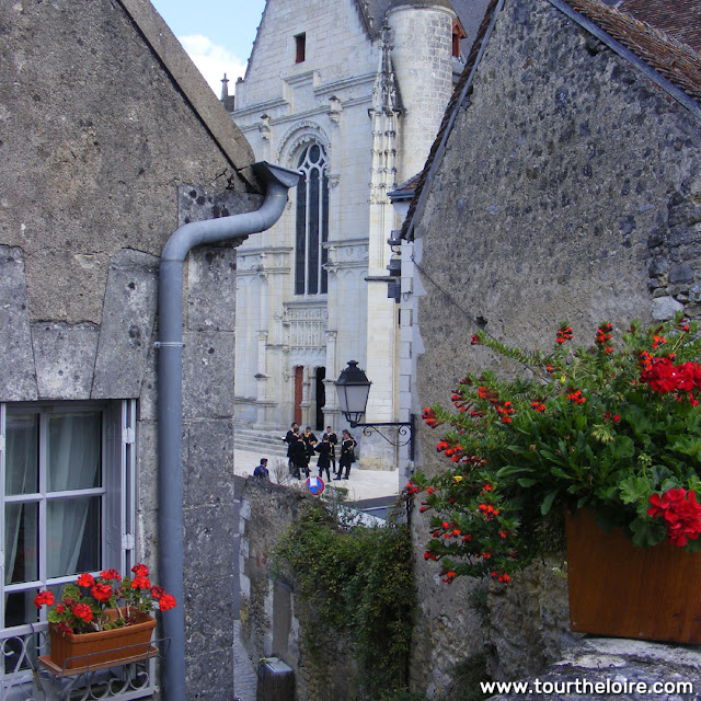 A glimpse of a church in the Loire Valley.  Indre et Loire, France. Photographed by Susan Walter. Tour the Loire Valley with a classic car and a private guide.
