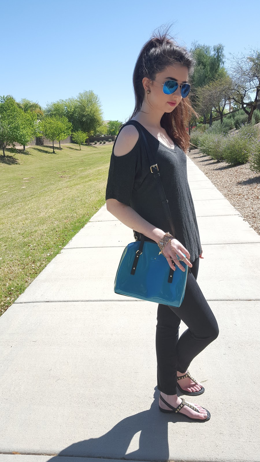 trendy spring outfit- cold shoulder tee and studded accessories