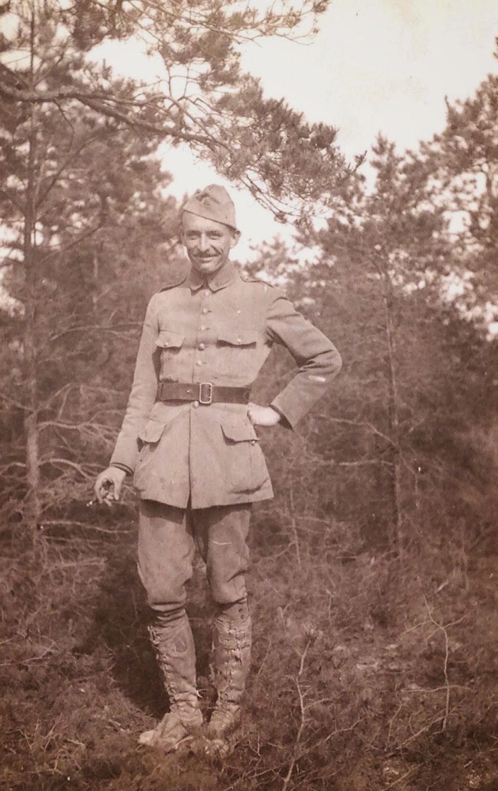 A photograph of a man in uniform.