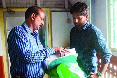 CID official checks documents in the office of the chief medical officer of health in Jalpaiguri