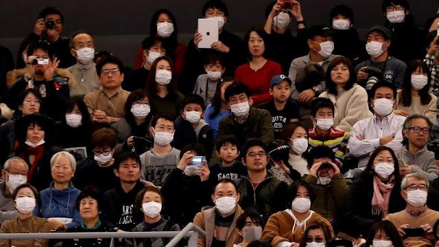 Japoneses%2Bm%25C3%25A1scara%2B%2528Kim%2BKyung-Hoon-%2BReuters%2529