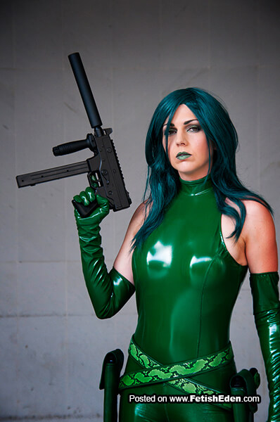 Madame Hydra cosplay green-haired lady in green latex outfit with long green latex gloves
