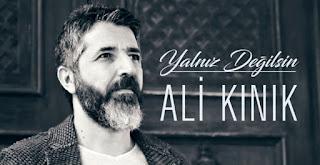 Ali Kınık Yalnız Değilsin Şarkı Sözleri