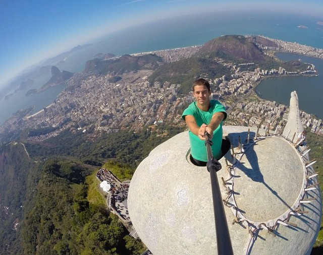 Reckless check-in on top of Christ the Redeemer statue
