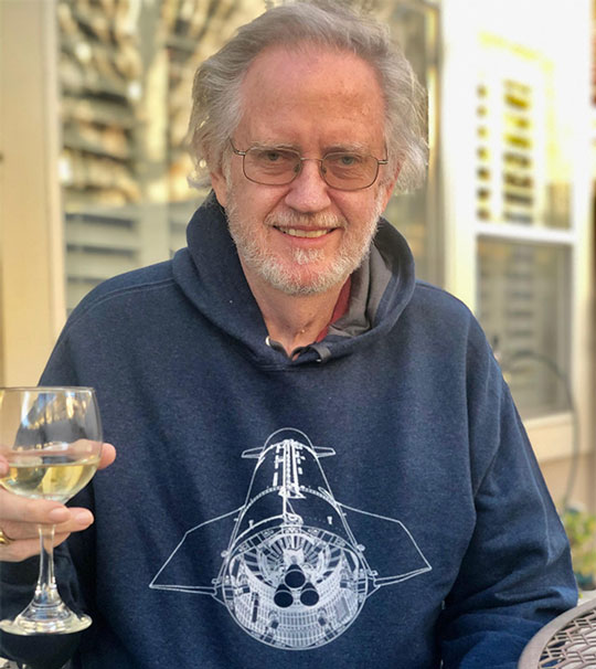Resident Astronomer enjoying wine and new Starship hoodie on the patio (Source: Palmia Observatory)