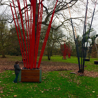 Boy in park with red posts