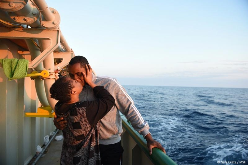 Nigerian man and his wife share kiss after getting rescued from sea