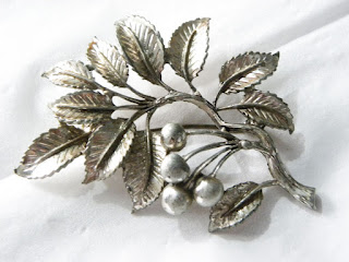Silver cherry leaf brooch by Exquisite
