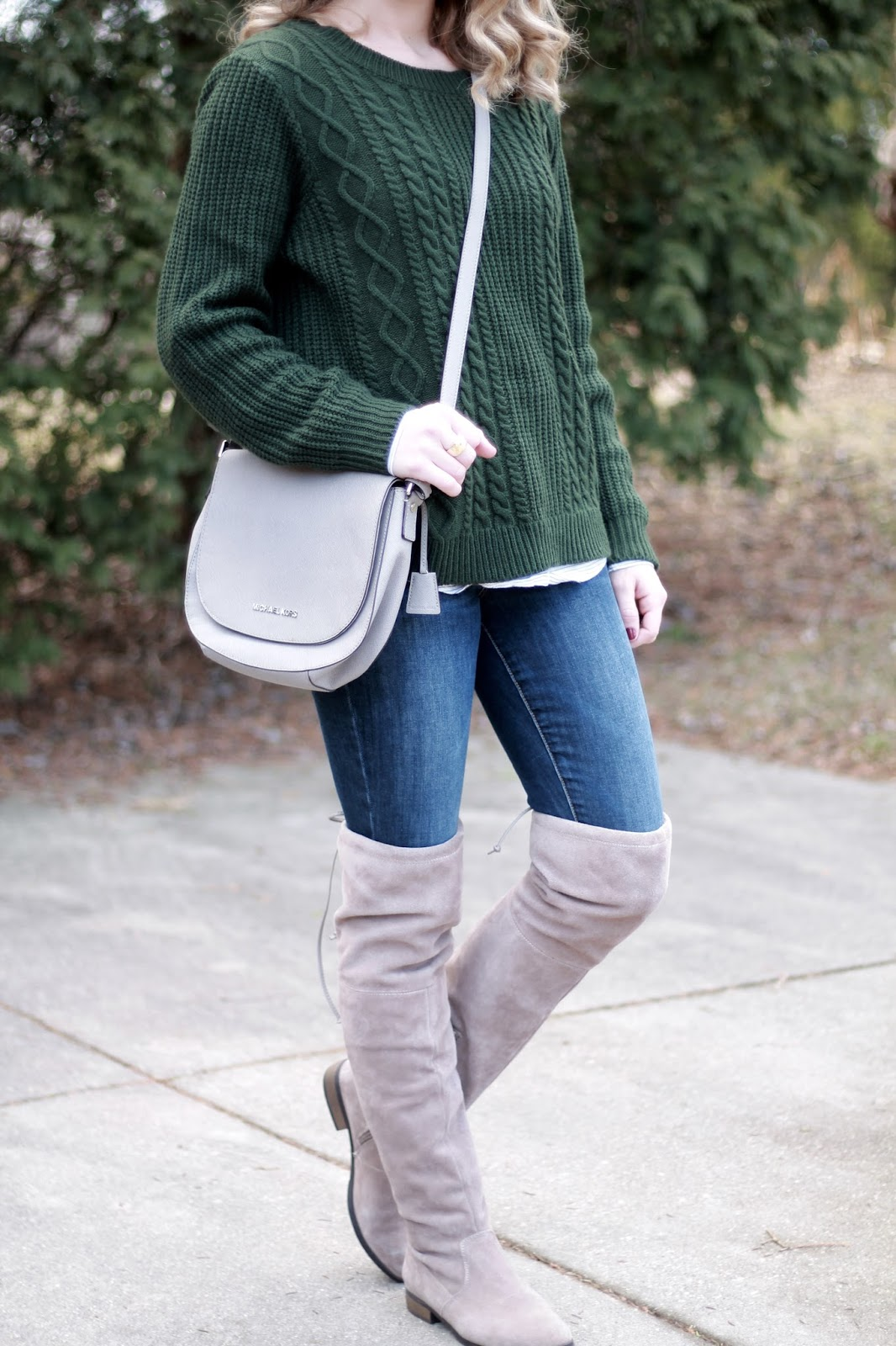 striped shirt, dark green cable knit sweater, Old Navy Rockstar jeans, OTK taupe boots, Michael Kors grey crossbody bag,