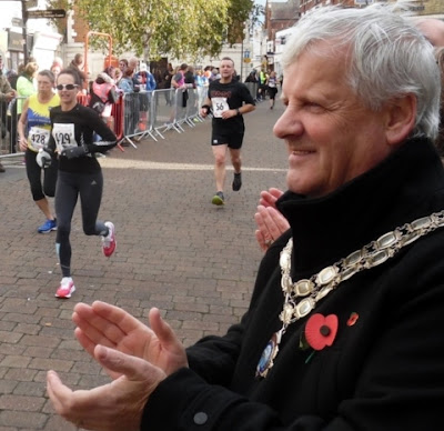 Picture: Brigg Town Mayor Coun Donald Campbell applauding competitors in the Brigg Poppy 10k 2018 event - held in October - as they approach the finishing line - see Nigel Fisher's Brigg Blog