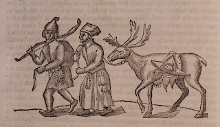 Woodcut of a man and woman leading a reindeer