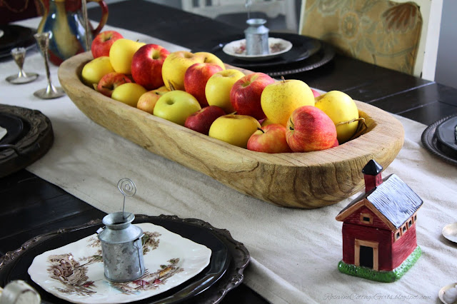 photo of Simple table decorated with a wooden bread bowl filled with red and yellow apples. Table set for a meal  apple tablescape, farmhouse table decor, Fall Decor, Autumn Decorating, Table Decor, Cottage, Country, Natural Decor,