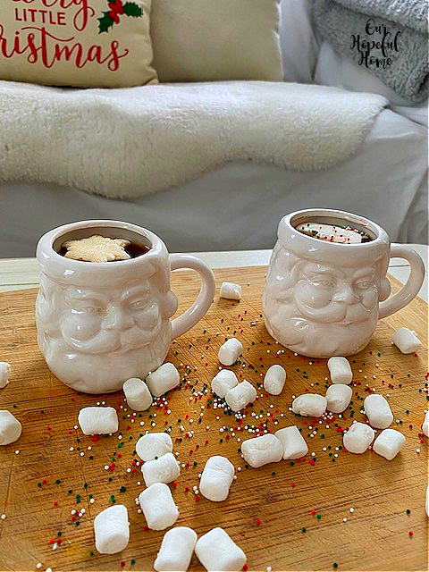 two white Santa Claus cocoa mugs snowflake marshmallow toppers
