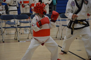 Karate kid sparring at Denver metro area Martial Arts Taekwondo Tournament