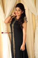 Kannada Actress Divya Uruduga Pos in Black Long Dress at Huliraaya Movie Audio Release Event  0006.jpg