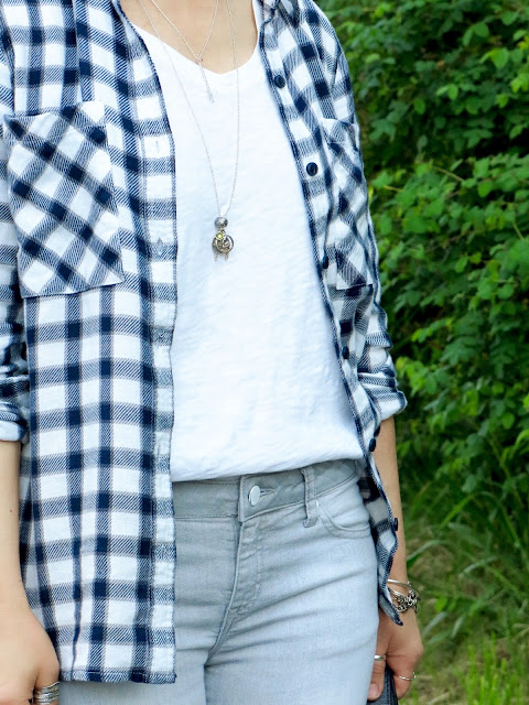 white tee, plaid flannel shirt, grey skinny jeans