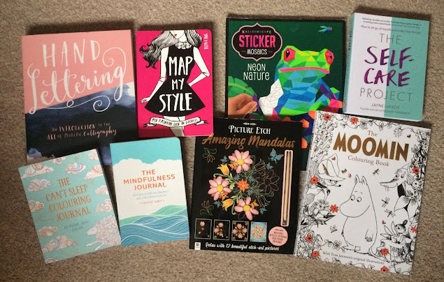 Selection of activity books including hand lettering, a fashion journal, colouring books and a stick by numbers book