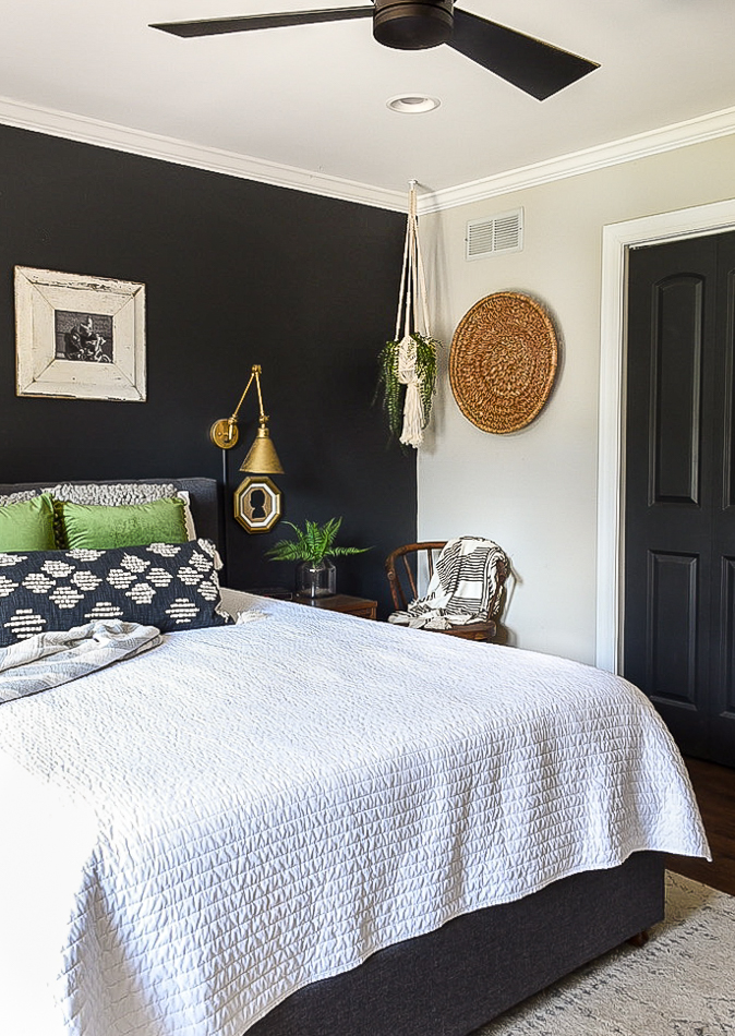 Bold and moody bedroom with green pillows