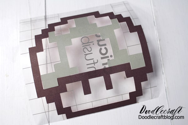 Now, carefully peel off the green infusible ink and place it in the cap of the mushroom outline with the ink side up.
