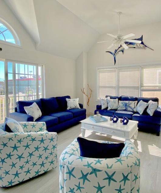 Coastal Upholstered Starfish Swivel Chair