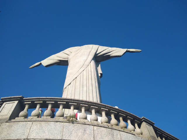 The back of Cristo Redentor with a blue sky in the background.