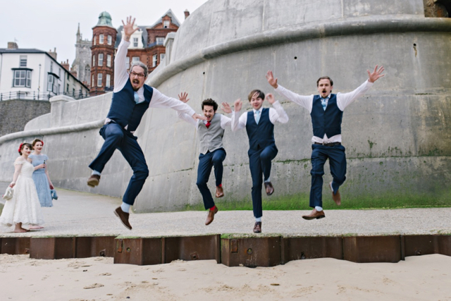 Groomsmen in navy, baby blue and red at vintage seaside wedding