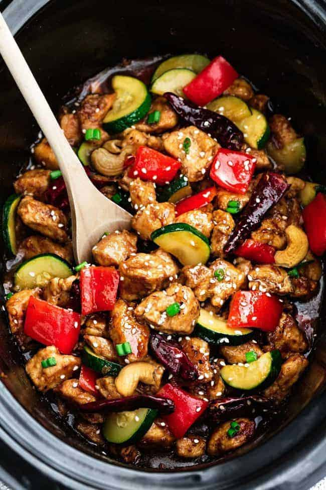 This delicious Skinny Slow Cooker Kung Pao Chicken is coated in a sweet and spicy sauce with tender vegetables and crunchy cashews.