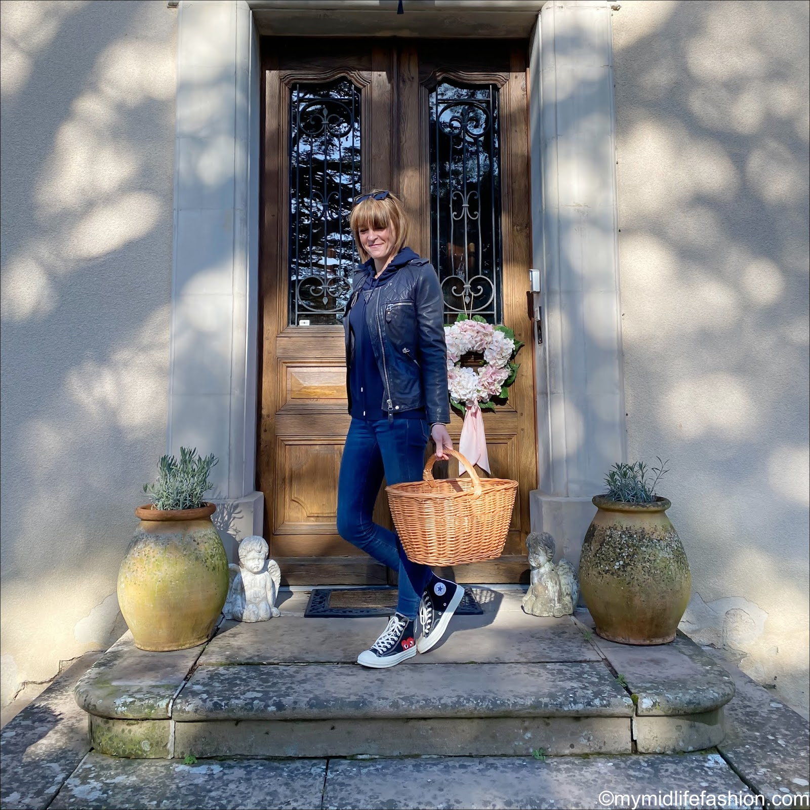 my midlife fashion, Isabel Marant Etoile leather jacket, marks and Spencer pure cashmere hoodie jumper, woven shopping basket, j crew 8 inch toothpick jeans, converse x comme des garçons play high tops
