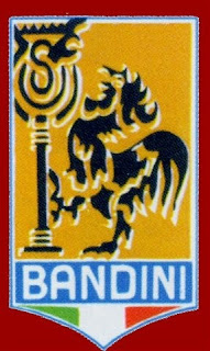 The Bandini badge, featuring the crowing bantam, symbol of Forlì