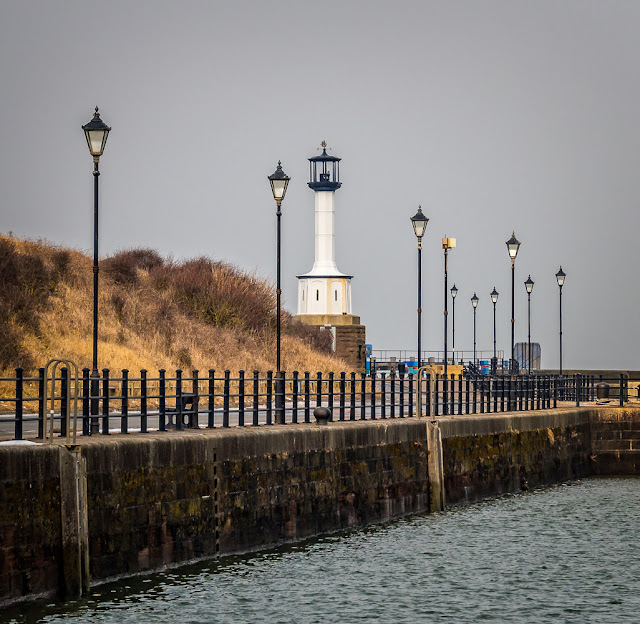 Photo of Maryport lighthouse at high tide