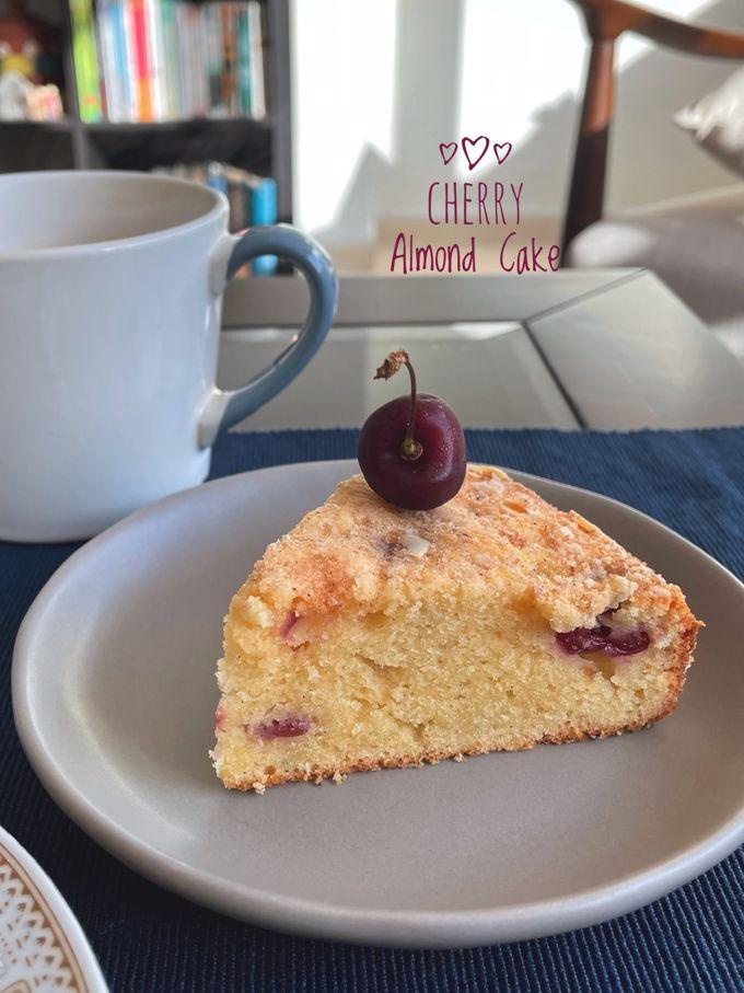 Cherry Almond Tea Cake slice topped with a fresh cherry