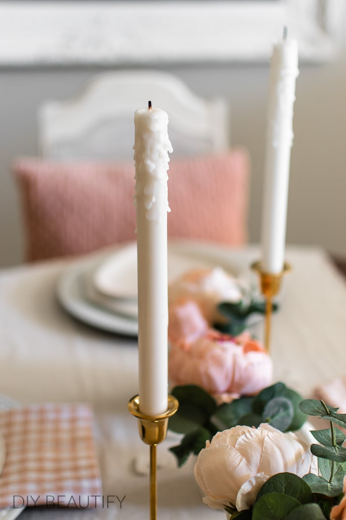 white candles and pink accents
